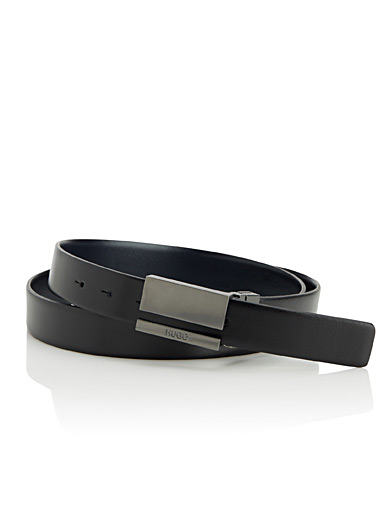 Negative space reversible belt