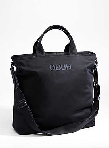 Reverse logo messenger bag