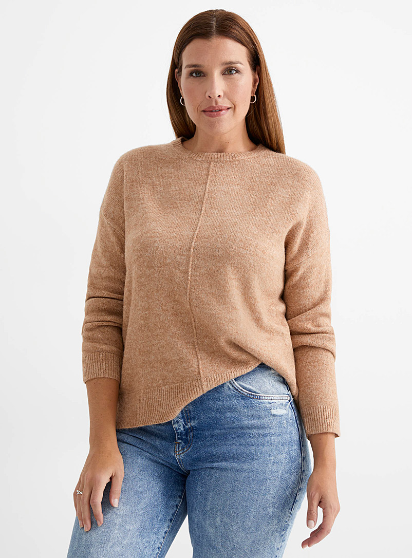 Le pull ample couture médiane