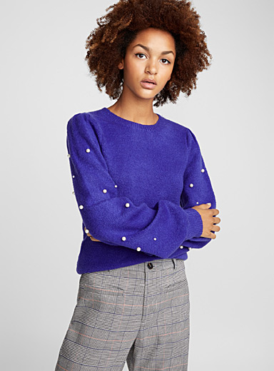 Le pull manches amples perlées
