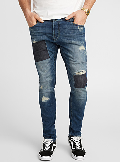 Distressed patchwork jean  Slim fit