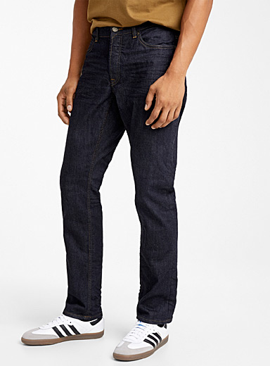 Dark indigo-dyed jean  Straight, slim fit