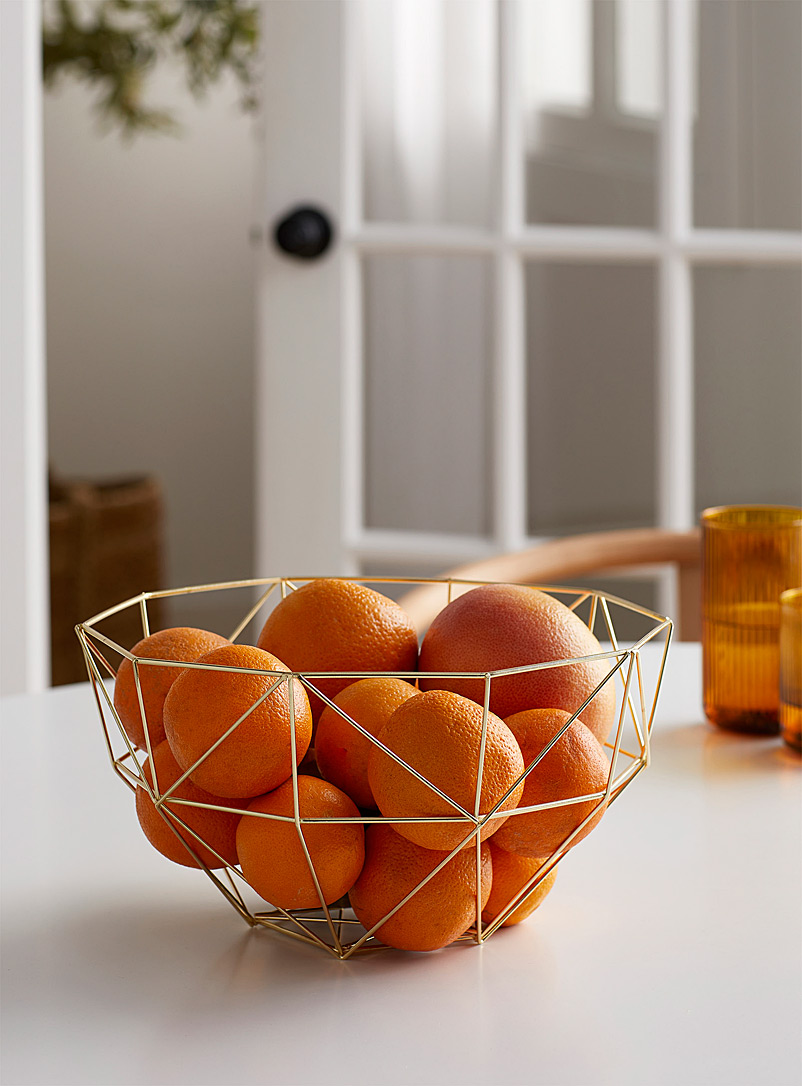 Gold metal fruit bowl