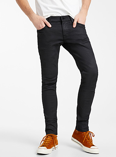 Le jeans noir enduit Tight Terry  Coupe super ajustée