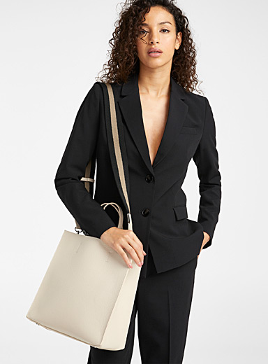 Minimalist leather tote and clutch