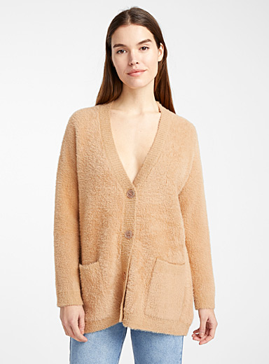 Le cardigan ample tricot poilu
