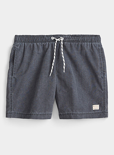 Washed-out solid swim trunk