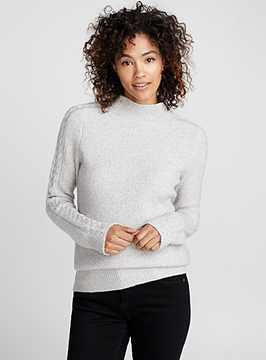 Twisted sleeve high-neck sweater
