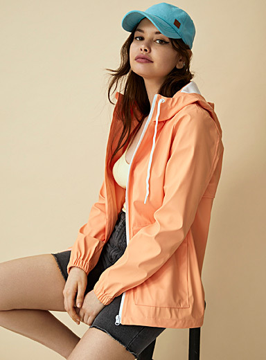 Twik Orange Contrast zip raincoat for women