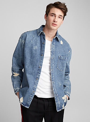 La surchemise en denim usé