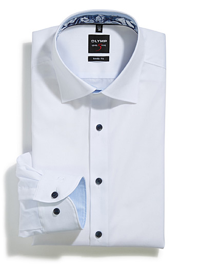 Piqué blue cuff shirt <br>Semi-tailored fit