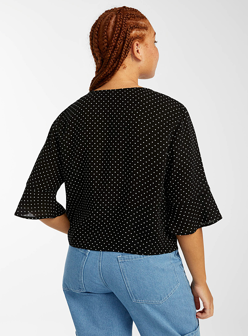 Twik Assorted Buttoned printed V-neck blouse for women