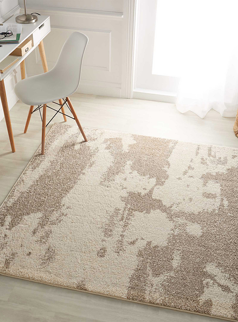 Sand spotted rug