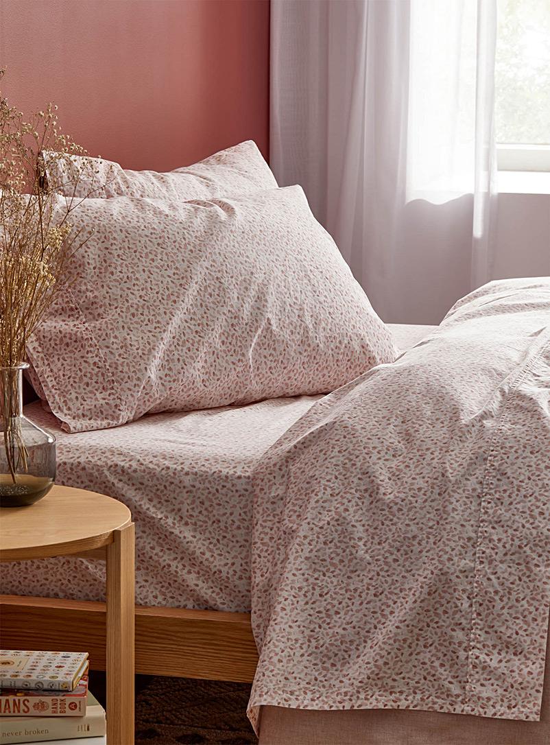 Petal-print 200 thread count organic cotton sheet set  Fits mattresses up to 16 in.