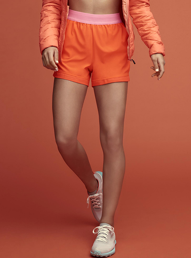 Le short de sport bordure filet - Shorts - Orange foncé