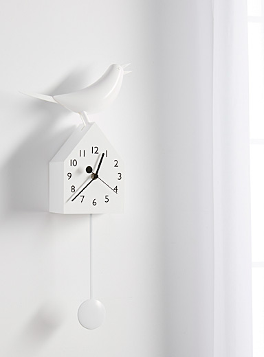 Moving white birdhouse clock
