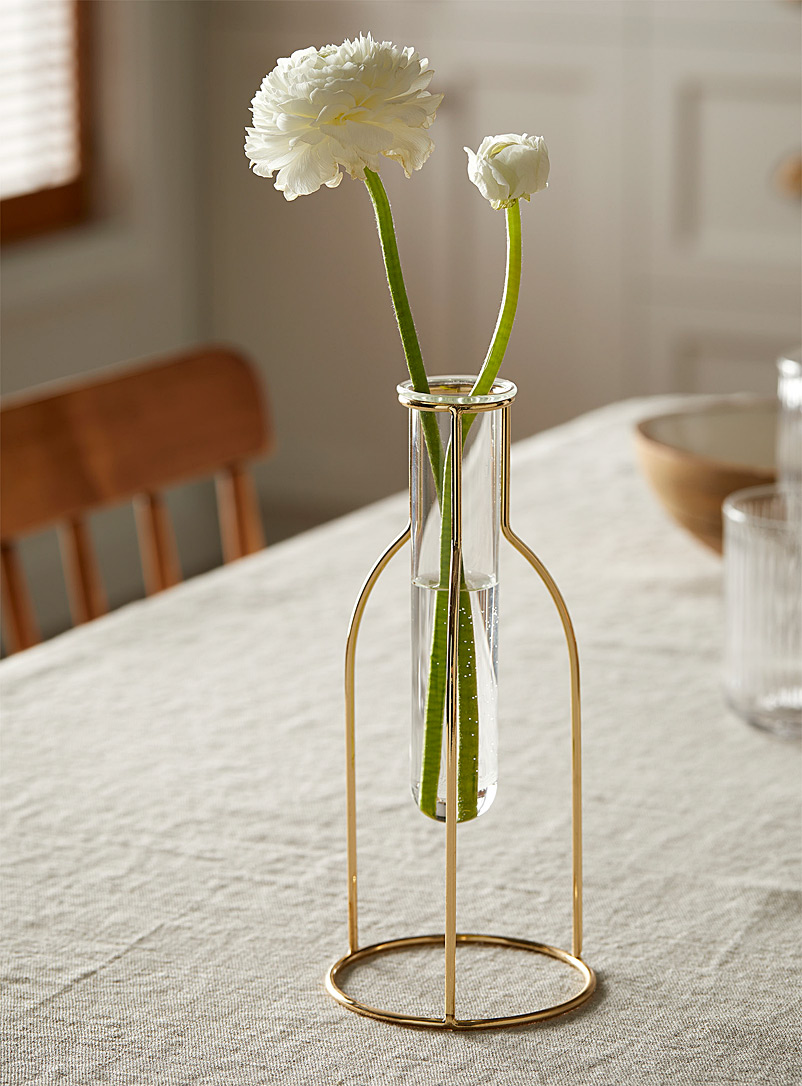 glass-vial-with-a-gold-holder