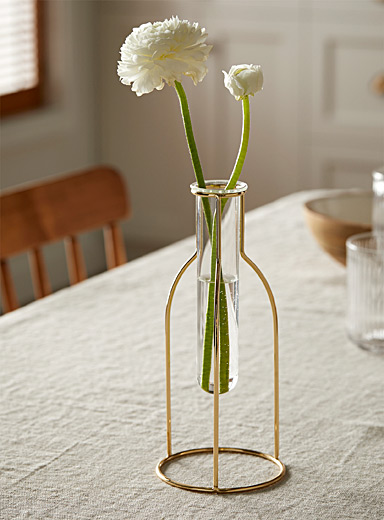 Glass vial with a gold holder