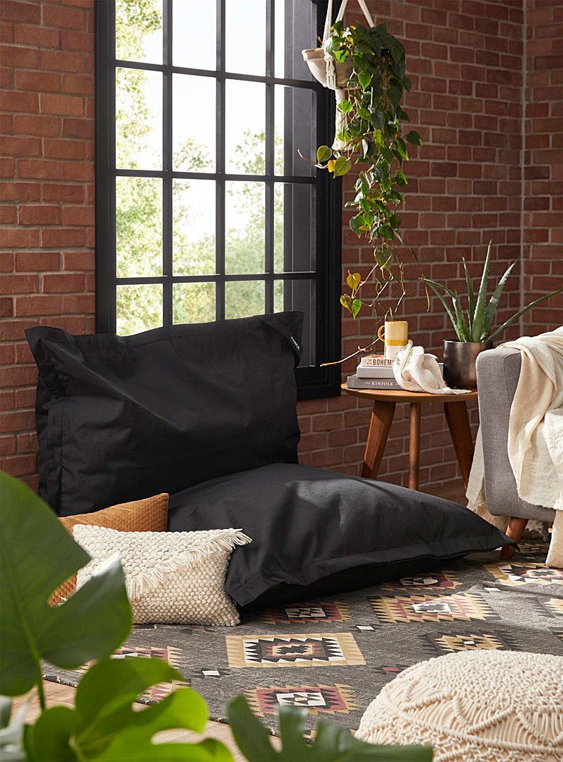 Norka Living Black Oversized saturated colour pouf
