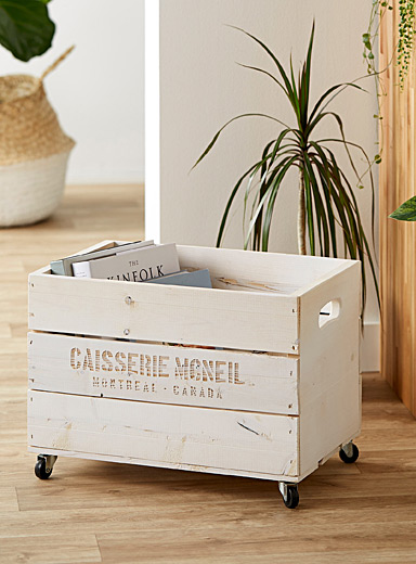 Bleached wooden chest on wheels