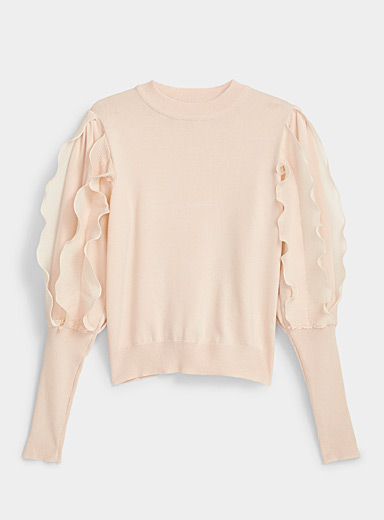 Le pull manches frisons