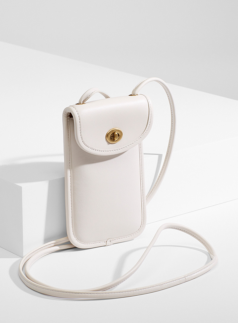 Turnlock ivory shoulder phone clutch