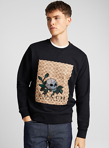 Le sweat broderie Skull
