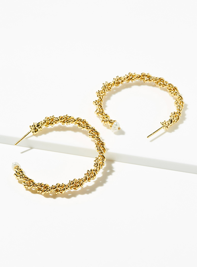 Pearl accent twisted hoops