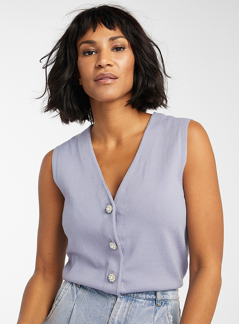 Icône Baby Blue Pearl-button vest for women