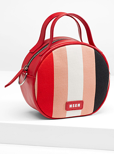 Graded circular shoulder bag