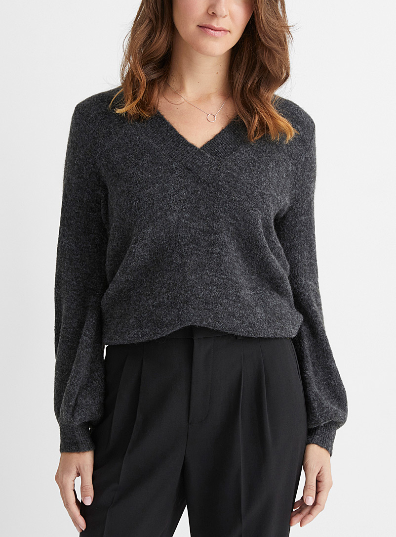 Le pull col V manches bouffantes
