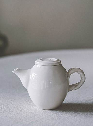 Braided handle porcelain teapot