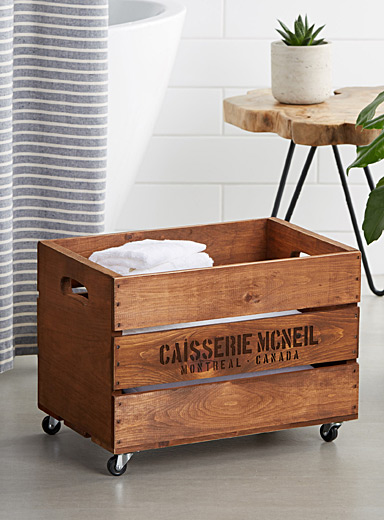 Rustic wooden chest on wheels