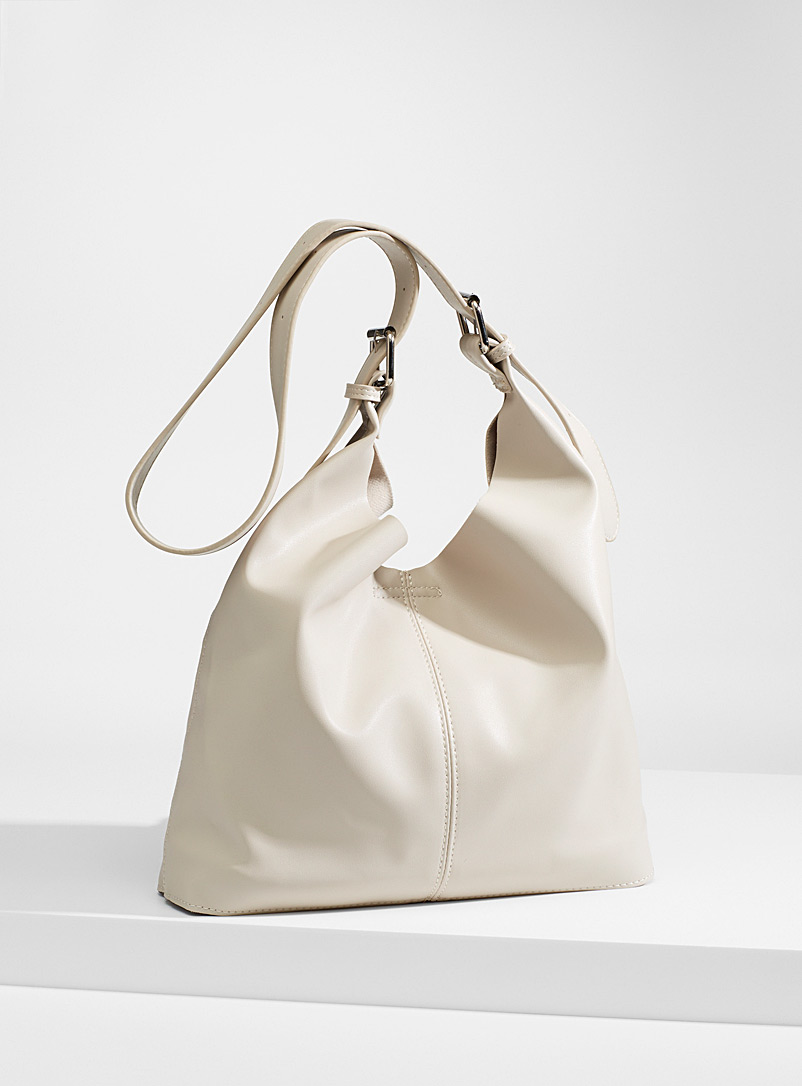 Simons Cream Beige Supple faux-leather saddle bag and clutch for women