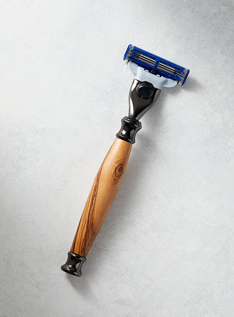 Au tournant de l'art  The olive wood of Bethlehem Wood and chrome razor
