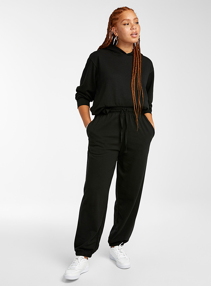 Twik Black Terry-lined loose joggers for women