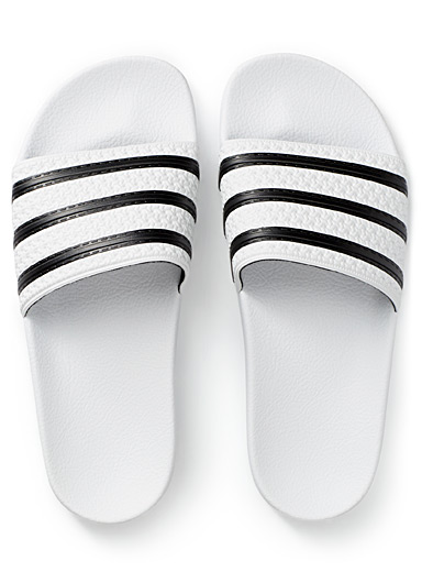 White-and-black Adilette slides