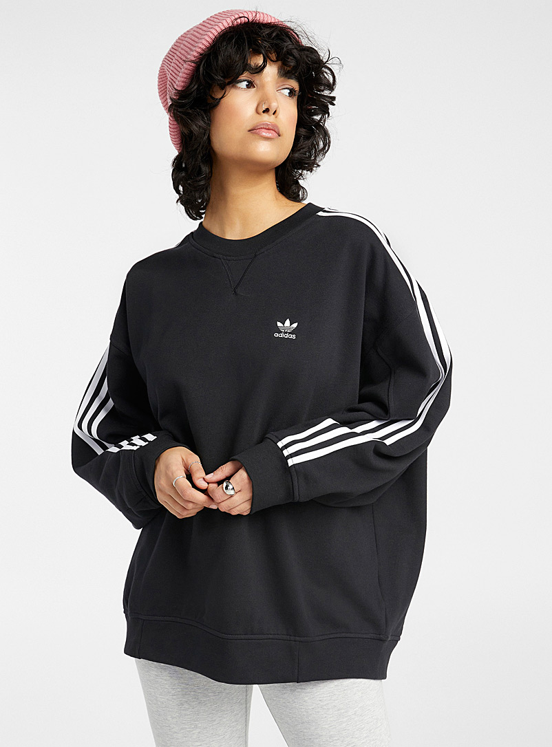 Le sweat ample trois rayures
