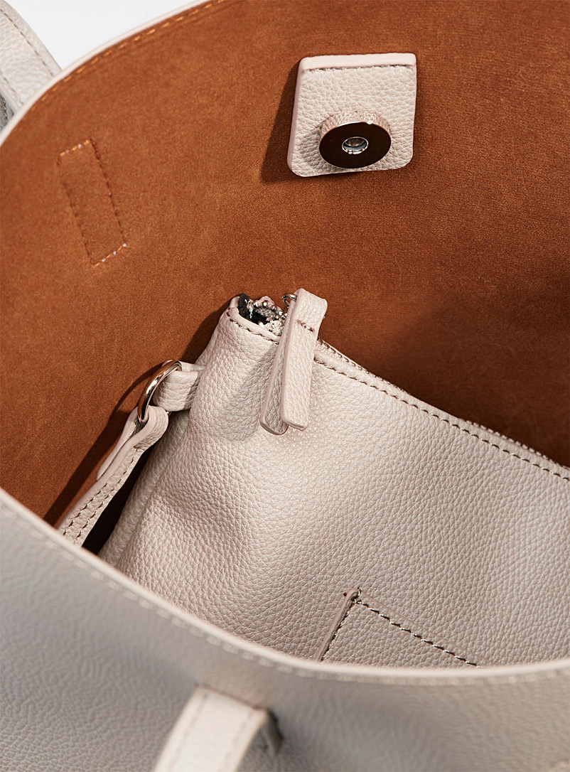 Simons Ivory White Trapeze tote and clutch for women