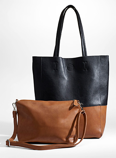 c1f4a0b765 Share. 1 review. Simons. Two-tone tote and clutch