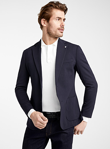 Le veston jersey construit mini pois <br>Coupe semi-ajustée