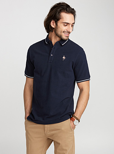 Le polo piqué accent tropical