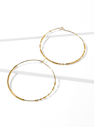Golden mini bead hoops