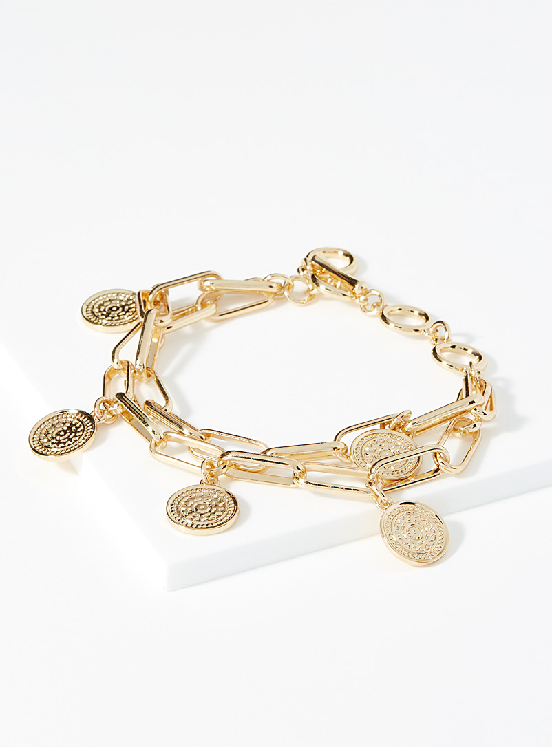 Simons Gold Medal and charm bracelet for women