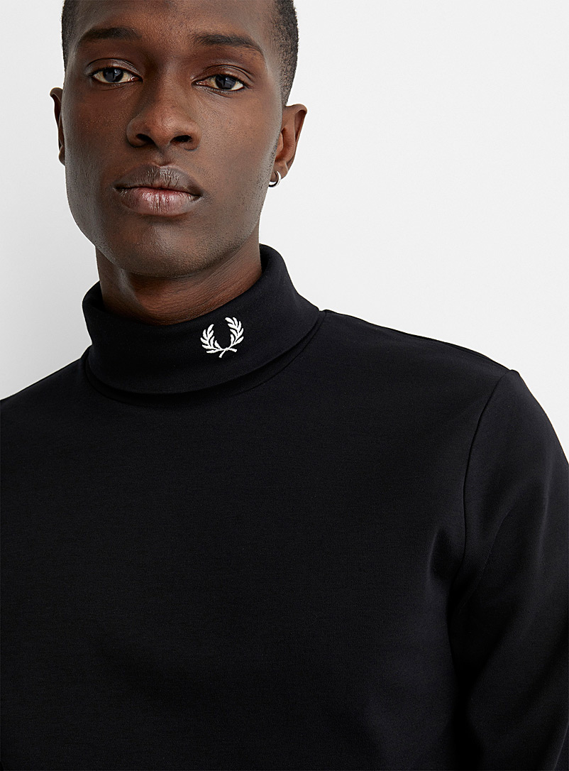 Embroidered emblem turtleneck