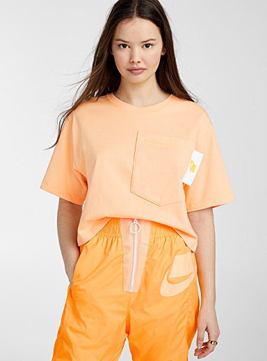 Orange mega-pocket tee