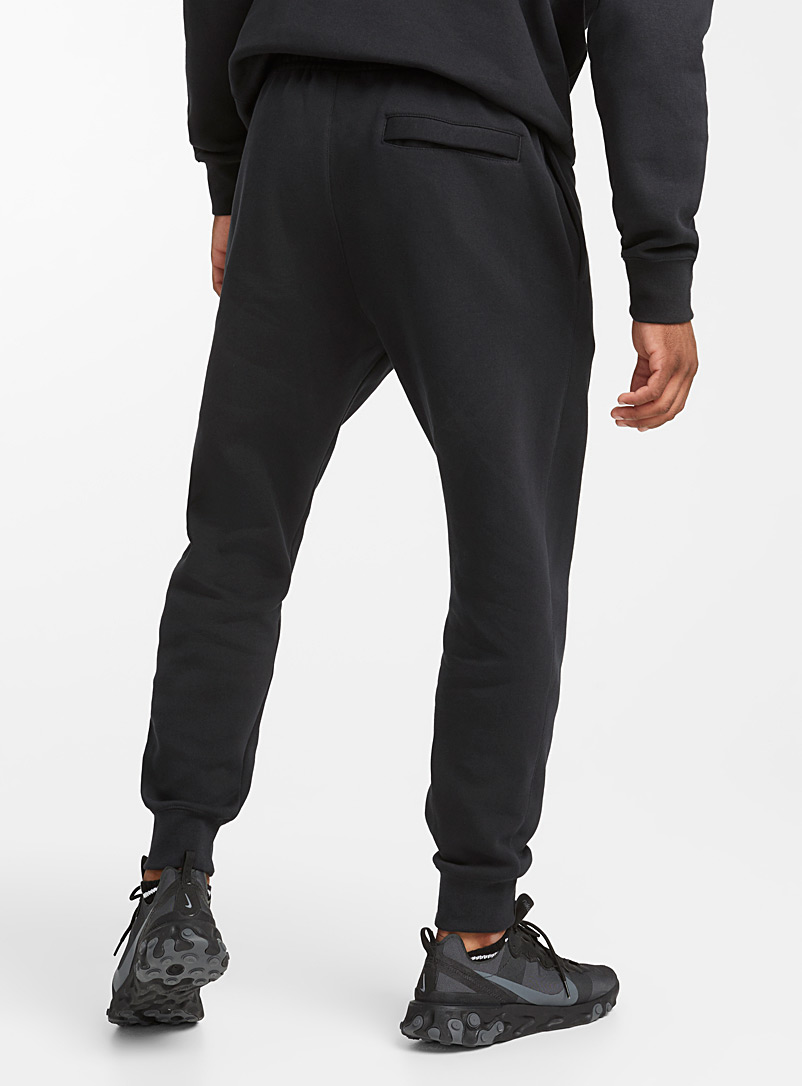 Embroidered Swoosh tapered joggers - Joggers - Black