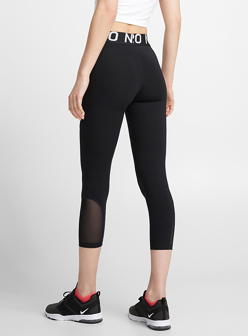 Nike: Le legging court insertion filet Noir pour femme