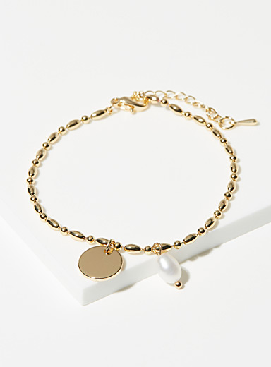 Charm and pearl bracelet