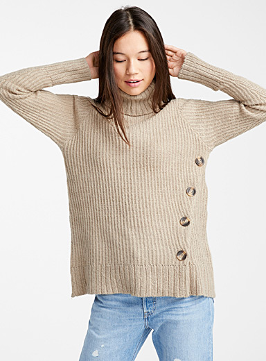 Asymmetric button turtleneck